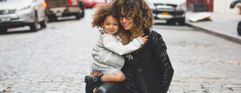 woman and child in street