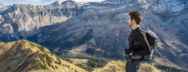 man looking out at scenic mountain landscape